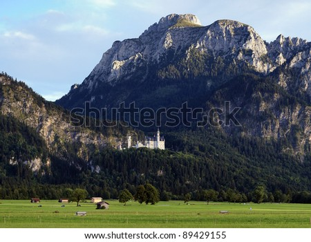Neuschwanstein Castle on the slope of the Bavarian Alps, Germany - stock photo