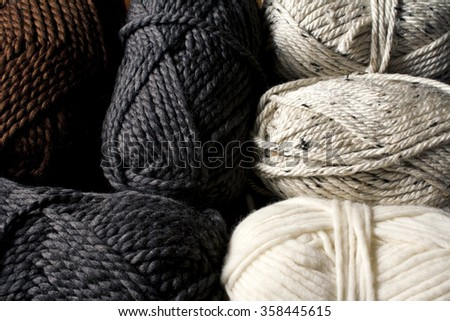 Neutral colored yarn skeins / Close-up of six balls of yarn in gray, beige, white and brown colors. - stock photo
