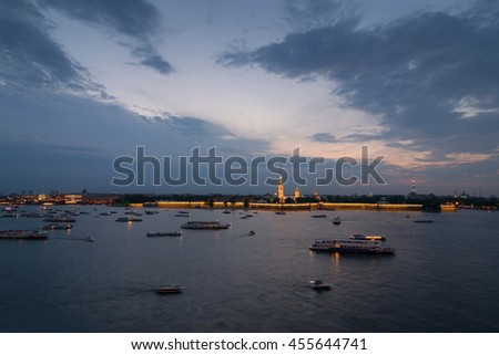 Neva river, ships, Peter and Paul fortress in Saint Petersburg, Russia in evening - stock photo