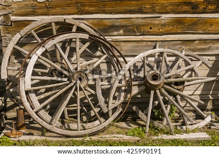 NEVADA CITY, MONTANA, USA - AUGUST 2004: Old wagon wheels. Located in Alder Gulch, Nevada City is an preserved 1860s historic gold rush frontier town.