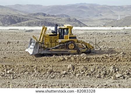 Nevada desert construction site with bulldozer - stock photo