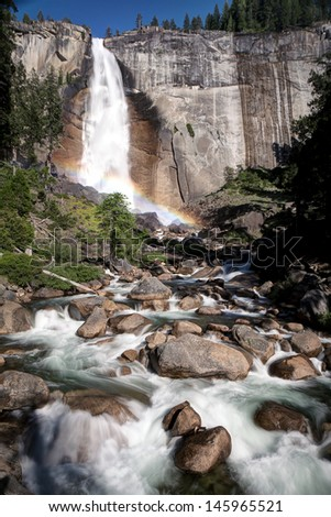 Nevada Fall is a 594-foot (181m) high waterfall on the Merced River in Yosemite National Park, California. It is located below the granite dome, Liberty Cap, at the west end of Little Yosemite Valley. - stock photo
