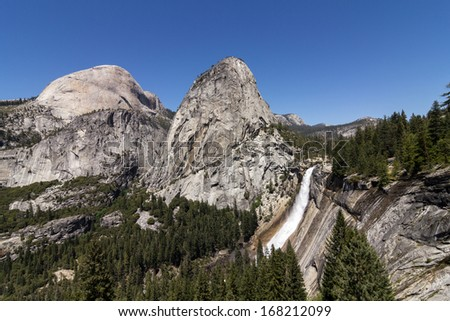 Nevada Fall with Liberty Cap and Half Dome - stock photo