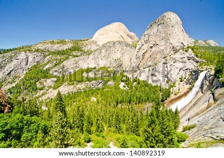 Nevada Falls, Liberty Cap, and Mount Broderick at Yosemite National Park. - stock photo