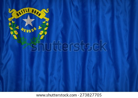 Nevada flag pattern with a peace on fabric texture,retro vintage style - stock photo