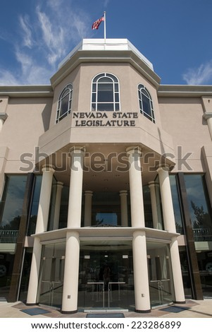 Nevada State Legislature building in Carson City, the Nevada state capital.  Set against a blue sky.  Government.  Vertical orientation. - stock photo