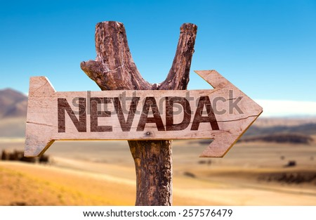 Nevada wooden sign with a desert background - stock photo