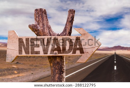 Nevada wooden sign with desert road background - stock photo