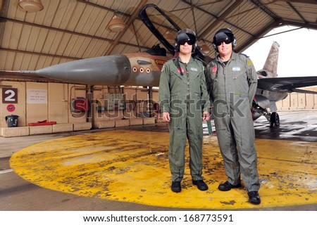 NEVATIM,ISR - APR 30:The best Israeli pilots stand beside Netz 107 on Apr 30 2010.It's the F-16 fighter jet with the highest number of interceptions and shot downs (7 enemy fighter jets) in the world. - stock photo