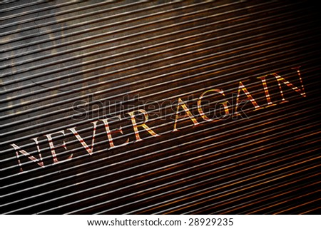 Never Again on Metal Texture - stock photo