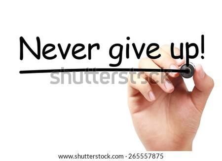 Never give up text is written on transparent white board by hand with marker isolated. - stock photo