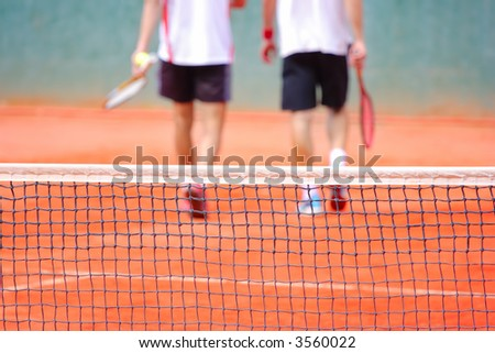 Never give up-Two tennis players leaving the tennis court - stock photo