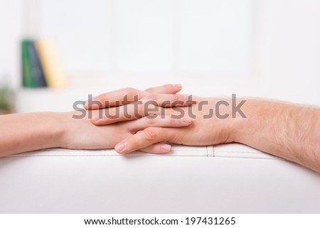 Never let you go. Close-up of man and woman holding hands - stock photo