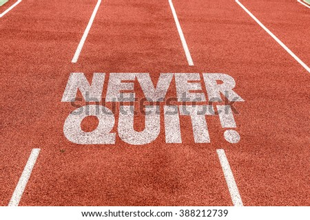 Never Quit written on running track