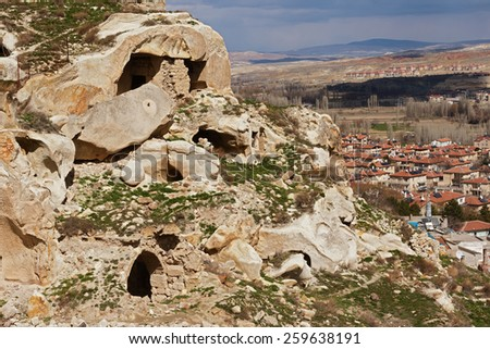 NEVSEH?R, TURKEY - MARCH 04, 2015:Cappadocia, Central Anatolia in Turkey. Desert landscape with ancient rock carved houses in Goreme turkish Kapadokya region in Asia Minor. - stock photo