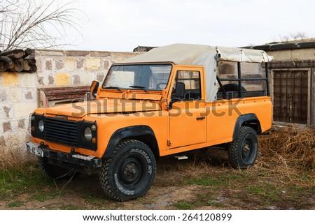 NEVSEHiR, TURKEY - MARCH 02, 2015: Orange jeep safari in Cappadocia. - stock photo