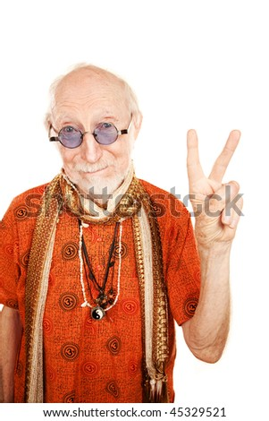 New age senior man in orange shirt making peace sign - stock photo