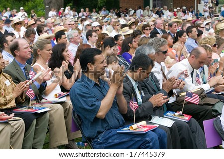 New American citizens applaud at Independence Day Naturalization Ceremony on July 4, 2005 at Thomas Jefferson's home, Monticello, Charlottesville, Virginia. - stock photo