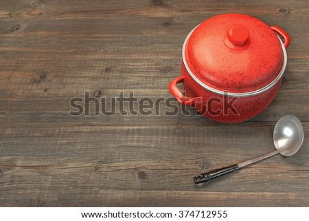New And Clean Two Covered Red Saucepan On The Rough Rustic Brown Wood Table Background, Overhead View, Copy Space - stock photo