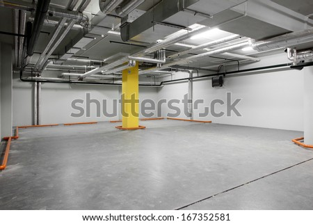 new and modern interior of grey parking - stock photo