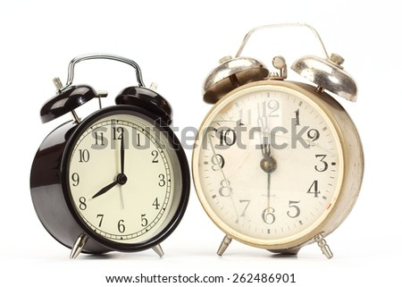 new and old broken alarm clocks over white - stock photo