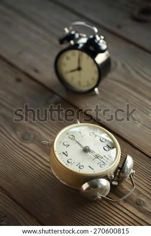 new and old broken alarm clocks, shallow dof - stock photo