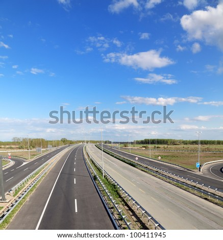 New and old highway with blue sky in perspective