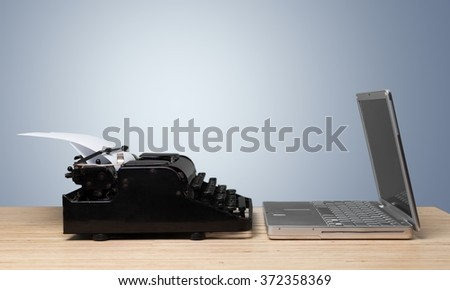 New and old typing machines. - stock photo