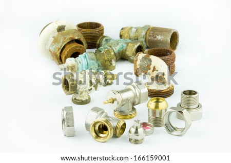 New and rusty valves and threads isolated on white - stock photo