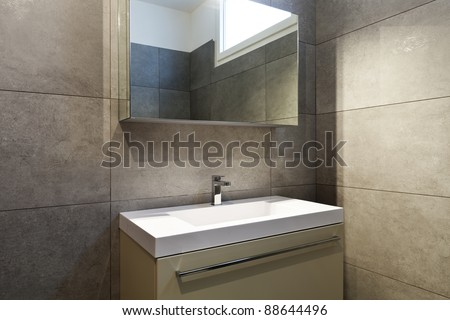 new apartment, bathroom, sink and mirror - stock photo