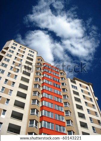 new apartment building over blue sky - stock photo