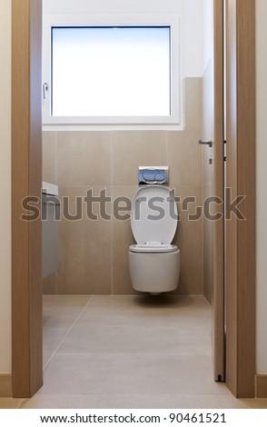 new apartment, door open, view wc - stock photo