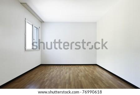 new apartment, empty room with  hardwood floor - stock photo