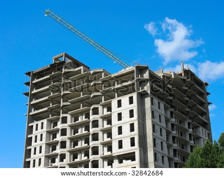 New apartment house construction over blue sky background
