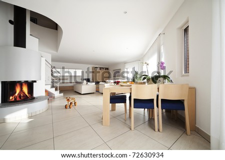 new apartment, large living room with fireplace - stock photo