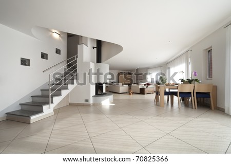 new apartment, large living room with stairs - stock photo