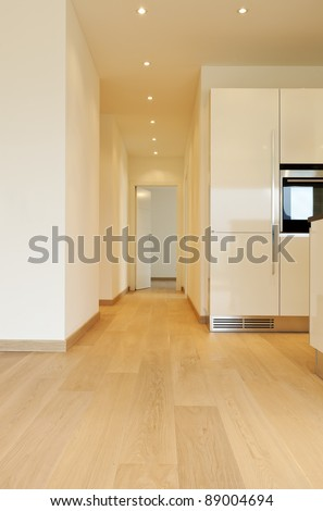 new apartment, room with kitchen, long corridor - stock photo