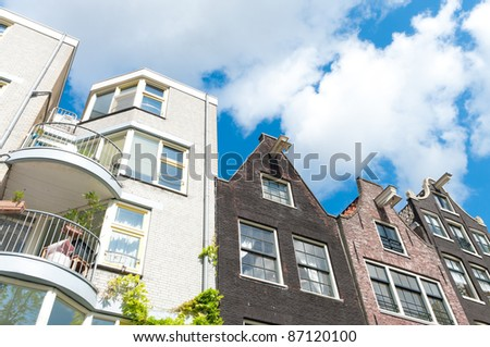 new apartments next to some monumental houses in amsterdam - stock photo