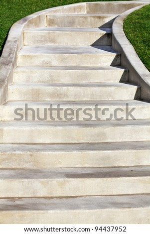 New Ascending Concrete Staircase with green grass on edges - stock photo