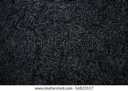 New asphalt on a road - stock photo