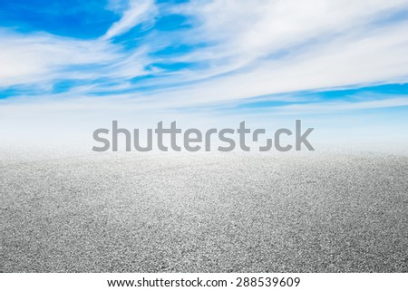 new asphalt road and sky background - stock photo