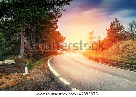 New asphalt road at sunset in the Apennines, Italy. - stock photo