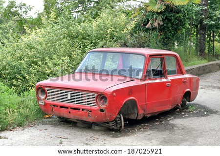 NEW ATHOS, ABKHAZIA - JULY 23, 2009: Abandoned soviet motor car VAZ 2101 Zhiguli at the city street. - stock photo