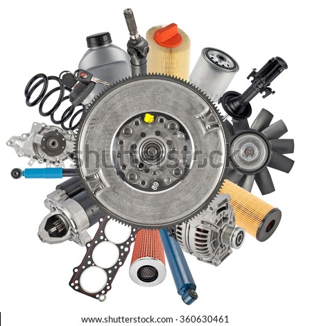 New auto spare parts around flywheel damper isolated on white background - stock photo