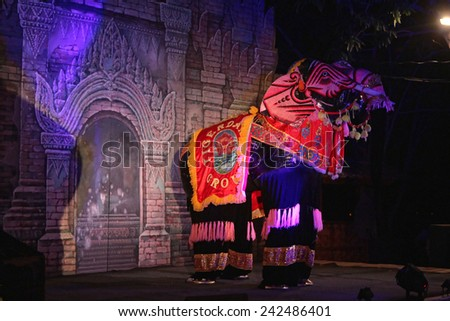 NEW BAGAN, MYANMAR, December 10, 2014 : An Elephant dances trough the scene of a well-known restaurant. The town is just few kilometers away from old Bagan, a popular tourist attraction. - stock photo