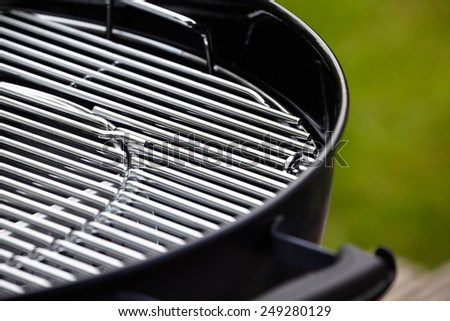 new barbecue grill in summer garden, outside, nobody  - stock photo