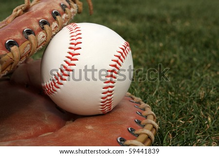 New Baseball in a Glove on grass