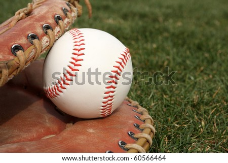New Baseball in a Glove on the field