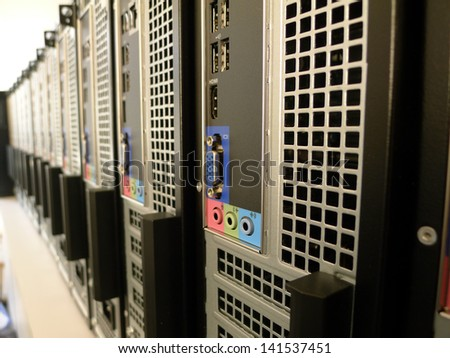 New batch of PC's ready for setup and deployment in a large office environment - stock photo