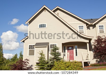 new beautiful American luxury houses at sunny day with green grass
